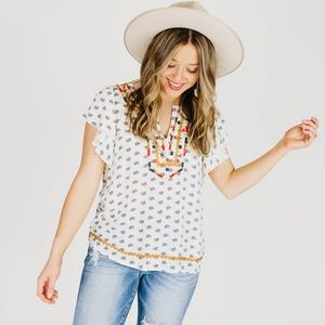 Tops - Embroidered cream and multi-colored blouse